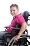 Junger Junge im Rollstuhl Stockfotos