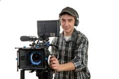 Junger Kameramann mit Filmkamera Stockfotos