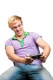 Junger Kerl, der Videospiele spielt Lizenzfreies Stockfoto