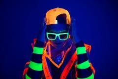 Junger Kerl im kreativen Kostüm mit Neonglühen Stockfotos