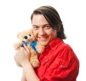 Junger Kerl mit seinem geliebten Spielzeug Stockbild