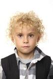 Junger kleiner Junge auf Weiß Stockbild