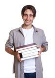 Junger Kursteilnehmer mit Büchern Lizenzfreie Stockfotos