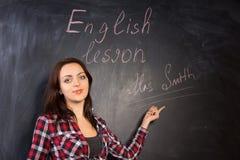Junger Lehrer, der zur Klasse sich vorstellt Lizenzfreies Stockfoto