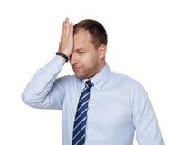 Junger müder, unglücklicher, umgekippter Geschäftsmann lokalisiert auf Weiß Lizenzfreies Stockfoto