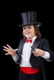 Junger Magier, der einen Trick durchführt stockfotos