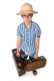 Junger Mann in den Gläsern mit zwei Taschen bereit zu reisen Lizenzfreies Stockfoto