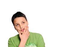 Junger Mann in denkender Haltung Stockfotos