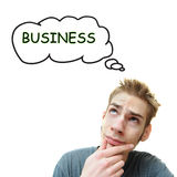 Junger Mann denkt Geschäft Lizenzfreies Stockfoto