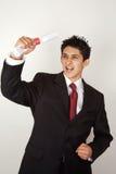 Junger Mann, der akademischen Erfolg feiert Lizenzfreies Stockfoto