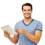 Junger Mann, der auf Digital-Tablet zeigt Lizenzfreies Stockfoto