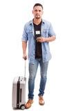 Junger Mann, der auf eine Reise geht Stockfotografie