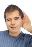 Junger Mann, der auf Klatsch hört Lizenzfreies Stockfoto