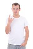 Junger Mann, der das Schwermetallstein-nrollenzeichen lokalisiert auf Weiß zeigt Stockbild