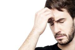 Junger Mann, der in der Hand Kopf hält Stockbilder