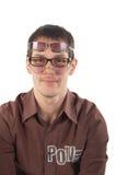 Junger Mann, der drei Gläser trägt Stockfotografie