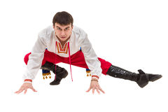 Junger Mann, der ein Volkskostüm aufwirft gegen lokalisiertes Weiß mit copyspace trägt Stockbild