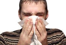 Junger Mann, der eine Kälte oder eine Allergie hat Lizenzfreies Stockbild