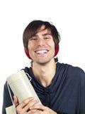 Junger Mann, der einen Röhrengeschenkkasten anhält Lizenzfreie Stockbilder
