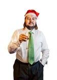 Junger Mann, der einen Weihnachtshut mit dem Glas Champagner lokalisiert trägt Lizenzfreies Stockfoto