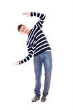 Junger Mann, der etwas darstellt Stockfotografie