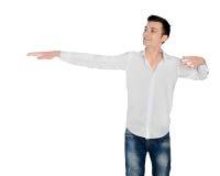 Junger Mann, der etwas darstellt Stockbilder
