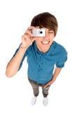 Junger Mann, der Fotos macht Stockfotografie