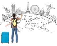Junger Mann, der globale Karte und berühmten Markstein zeichnet Stockbild