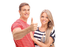 Junger Mann, der mit seiner Freundin aufwirft Lizenzfreie Stockbilder