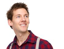 Junger Mann, der oben lächelt und schaut Lizenzfreies Stockbild