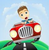 Junger Mann, der schnelles klassisches Auto antreibt Stockbild