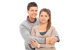 Junger Mann, der seine Freundin umarmt Stockbilder