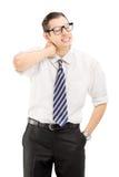 Junger Mann, der unter Nackenschmerzen leidet Stockbild