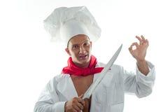 Junger Mann des Kochs und großes Messer stockfotos