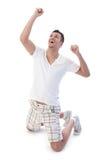 Junger Mann glücklich für Sieg Stockfotografie