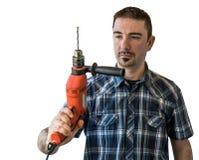 Junger Mann-Holding und elektrische Bohrmaschine Lizenzfreie Stockbilder