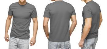 Junger Mann im leeren grauen T-Shirt, Front und hintere Ansicht, lokalisierte weißen Hintergrund Entwerfen Sie Mannt-shirt Schabl stockfotos