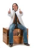 Junger Mann im Pelzmantel Stockbild