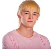 Junger Mann im rosafarbenen Hemd Stockbilder