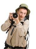 Junger Mann kleidete in einem Touristen an stockbild