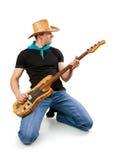Junger Mann mit Baß-Gitarre Lizenzfreie Stockfotos