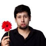 Junger Mann mit Blumen Stockfoto