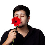 Junger Mann mit Blumen Stockfotografie