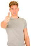 Junger Mann mit dem Daumen oben Stockfotos
