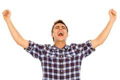 Junger Mann mit den Armen angehoben Stockbilder