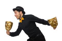 Junger Mann mit der goldenen venetianischen Maske an lokalisiert Lizenzfreie Stockfotografie