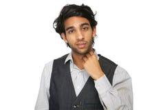 Junger Mann mit der Hand zum Gesicht Lizenzfreies Stockfoto