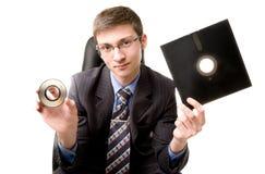 Junger Mann mit Diskette Stockbild