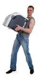 Junger Mann mit einem Drucker in den Händen von Stockfotografie