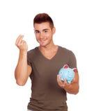 Junger Mann mit einem Geldkasten Stockfotografie